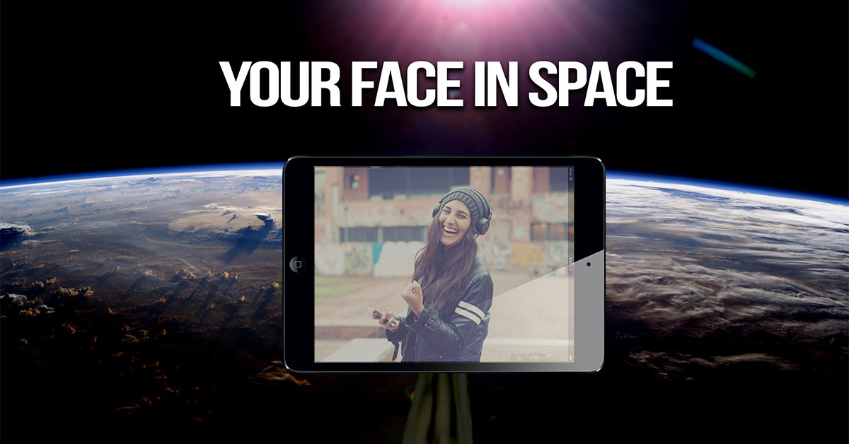 A photo of an iPad in space with a photo of a girl