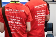 A picture of two reps wearing red tshirts at Rep Conference