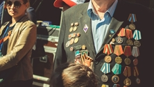A decorated veteran sporting many medals of honour