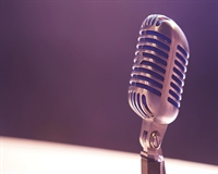 A photograph of a microphone on stage